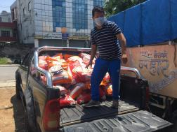 Narayan Pun, our vice-president loads our car